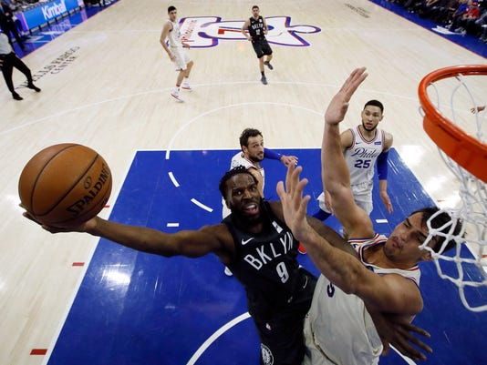 Brooklyn Nets' DeMarre Carroll, left, goes up to shoot against Philadelphia 76ers' Dario Saric during the first half of an NBA basketball game, Friday, March 16, 2018, in Philadelphia. (AP Photo/Matt Slocum)