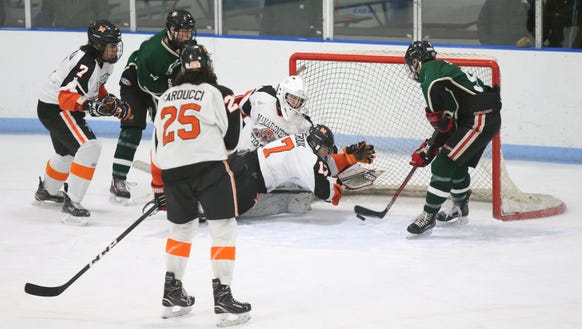 Mamaroneck's Sam Geroux (17) dives in the crease to
