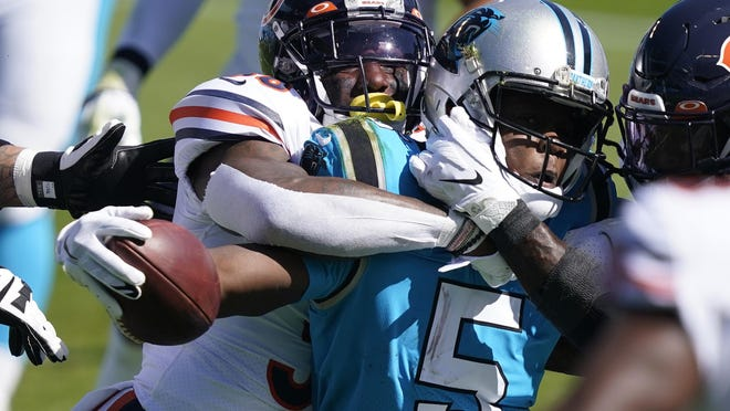 Chicago Bears strong safety Tashaun Gipson tackles Carolina Panthers quarterback Teddy Bridgewater (5) in Charlotte, N.C., on Sunday.
