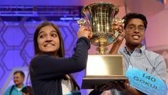 Co-champions Vanya Shivashankar, left, and Gokul Venkatachalam