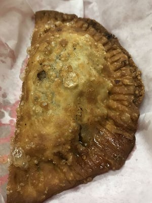 A beef empanada at Familia in Port St. Lucie. Empanadas are filled pastries that are baked or fried.