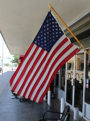 A flag flutters in the breeze outside a downtown Abilene business a day ahead of Flag Day, June 14.