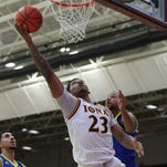 Iona's Jordan Washington (23) goes up underneath the basket during a mens basketball game against Delaware at the Hynes Center at Iona College in New Rochelle on Friday, Nov. 20, 2015.