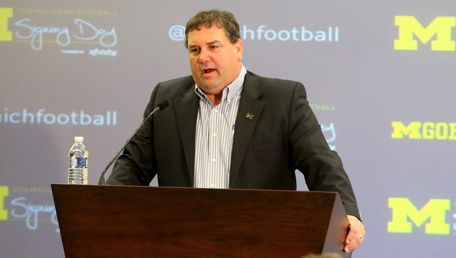 Michigan football coach Brady Hoke talks with reporters about his recruits Feb. 5, 2014, in Ann Arbor.