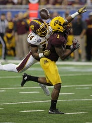 Central Michigan's Josh Cox (14) stops a reception