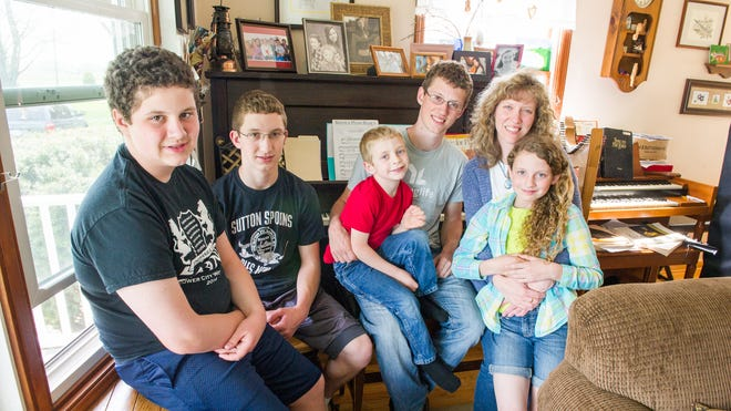 Jenny Honan of Spencerport with five of her seven children, all of whom are involved in the arts. Pictured from left, Josiah, 13, David, 16, Jimmy, 5, Andrew, 19, Jenny and Grace, 10.