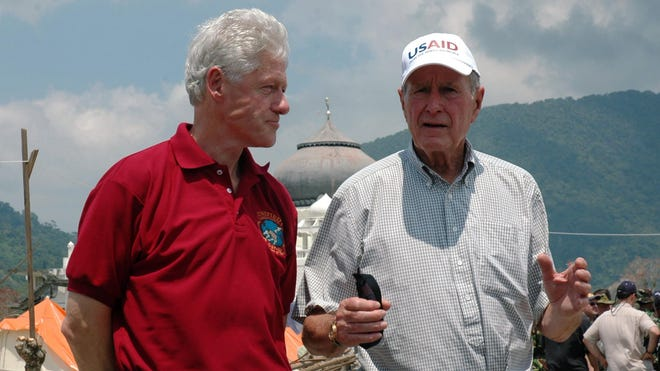 Former presidents Bill Clinton, left, and George H.W. Bush bonded when they traveled to Indonesia in 2005 after a devastating tsunami.