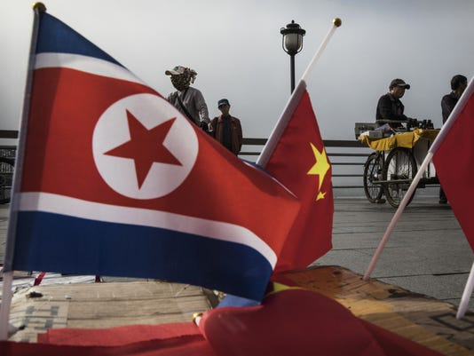 NORTH KOREA CHINA FLAGS