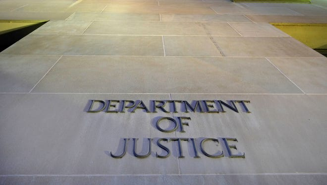 In this May 14, 2013, file photo, the Department of Justice headquarters building in Washington is photographed early in the morning.