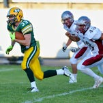 CMR's Trevor Pepin runs after the catch during Friday's game against Helena High,September 11, 2015.