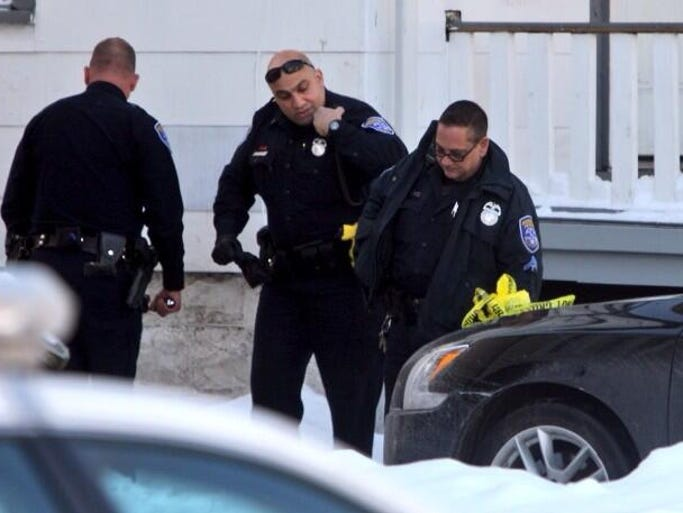 Police investigate a double shooting on Peck Street Thursday morning in Rochester.