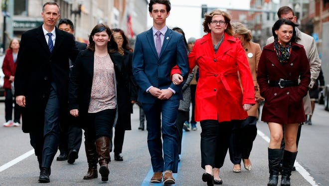 The family of Martin Richard, from left, Bill, Jane, Henry and Denise, walk down Boylston Street following a ceremony at the site where Martin Richard and Lingzi Lu were killed in the second explosion at the 2013 Boston Marathon, Sunday, April 15, 2018, in Boston. (AP Photo/Michael Dwyer)