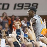 After an upset win over Kansas, Oklahoma State freshman point guard Jawon Evans is carried off the floor on Jan. 19