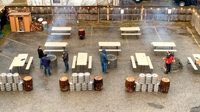 "Mitten Brewing Company in Grand Rapids is offering ""Base Camp"" seating outdoors during the winter months."