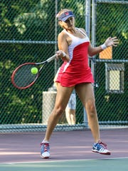 Mendham's Lindsey Hernandez hits a return to Kinnelon's Brittany Lau during a Morris County Tournament first singles semifinal at County College of Morris in Randolph on September 24, 2017.  Alexandra Pais/ The Daily Record