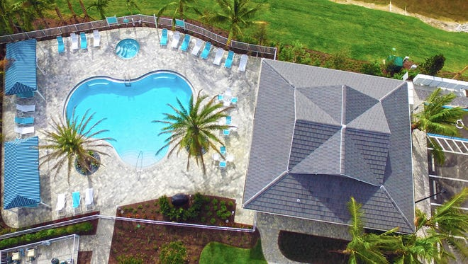 Clubhouse and resort-style pool at Avalon of Naples.