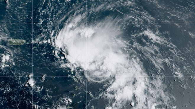 This satellite image released by the National Oceanic and Atmospheric Administration shows Tropical Storm Laura in the North Atlantic Ocean Friday.
