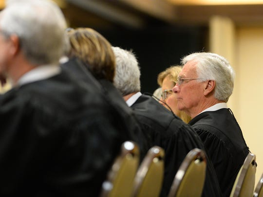 Supreme Court Justice Mike Wheat listens to oral arguments in the case of BLM v. South Phillips County Water Users Group on Friday at the Holiday Inn as part of the State Bar of Montana's annual meeting.