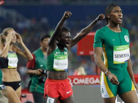 South Africa's Caster Semenya, right, wins the gold medal in the women's 800-meter final ahead of silver medalist Burundi's Francine Niyonsaba, center, and fourth placed Canada's Melissa Bishop during the athletics competitions of the 2016 Summer Olympics at the Olympic stadium in Rio de Janeiro, Brazil, Saturday, Aug. 20, 2016. (AP Photo/David J. Phillip)