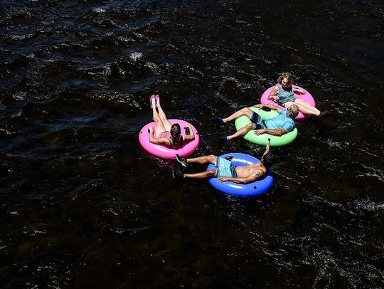 A group tubes down the Yampa River in Steamboat Springs