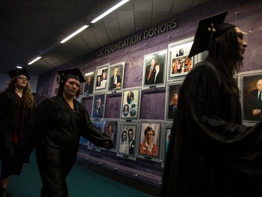 Graduates head toward the Henderson Fine Arts Performing