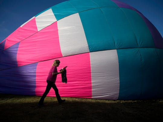 Debbie Peek of Albuquerque helps set up her balloon called O'Lough, Friday, June 16, 2017 at the Chamblee Soccer Complex in Bloomfield.