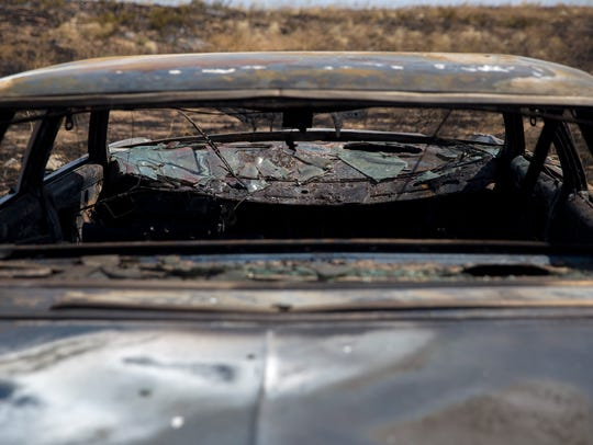 A vehicle burned during Tuesday's fire is pictured