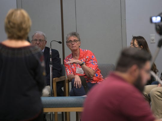 Kate Sullivan, center, of the U.S. Environmental Protection Agency, answers questions during a panel discussion on the long-term impact of the Gold King Mine spill Wednesday at San Juan College's Henderson Fine Arts Center in Farmington.