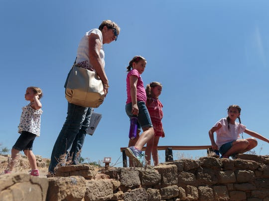 Yvette Hathaway, of Farmington, explores Aztec Ruins National Monument Tuesday with her grandchildren, Lily Orme, left Claire Orme, Evelyn Orme and Madison Orme.