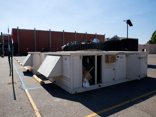 The school's old air conditioning unit and other materials sit in a parking lot waiting to be picked up for recycling Wednesday at Kirtland Central High School.