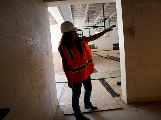 Candice Thompson, construction and facility coordinator with the Central Consolidated School District, leads a tour Wednesday at Kirtland Central High School.