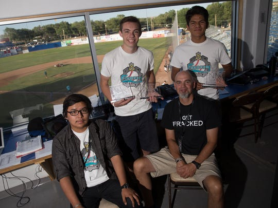 Terrell Kosea, left, Jonah Herman, Johnny Curry and Cameron Nez of the Farmington Frackers staff are also part of the crew that operate FHS Live at Farmington High School.