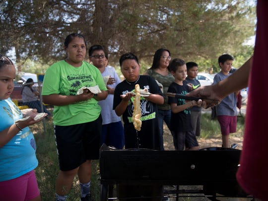 Participants in a youth conference wait to fry their bread Thursday during a program hosted by the Diné Relief Initiative at the Healing Circle Drop-In Center in Shiprock.