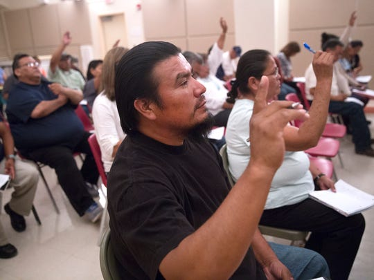 San Juan Chapter Vice President Shawn Mike votes on a resolution Thursday during a Northern Navajo Agency Council meeting at the San Juan Chapter house in Lower Fruitland.