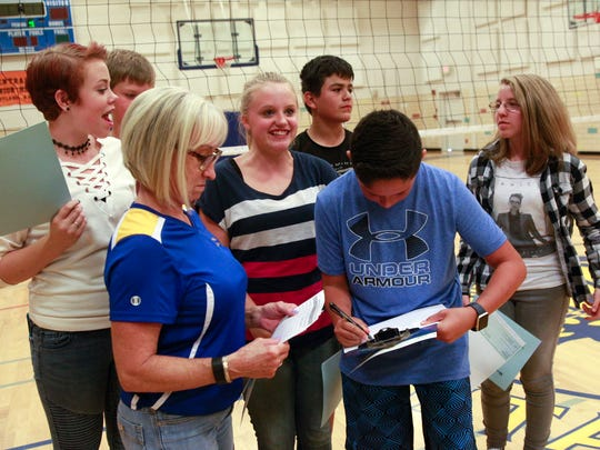 Mesa Alta Junior High School students collect a $100 dollar checks,  Friday, Aug. 18, 2017 at the Mesa Alta Junior High School in Bloomfield. Eight students recieved the money because of their high scores on the PARCC exams.