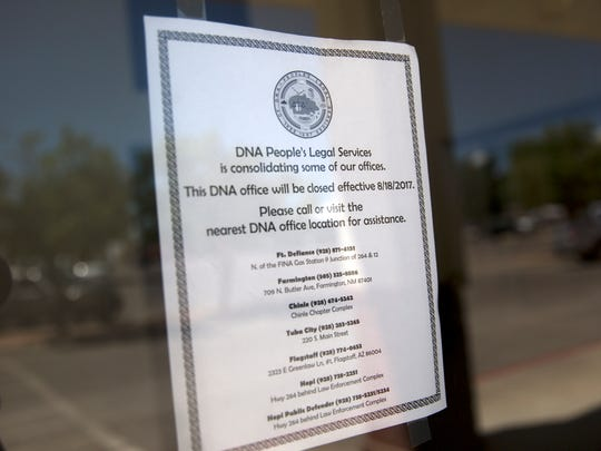 A sign explaining the closure of a DNA People's Legal Services, Inc. office in Shiprock is posted for visitors.