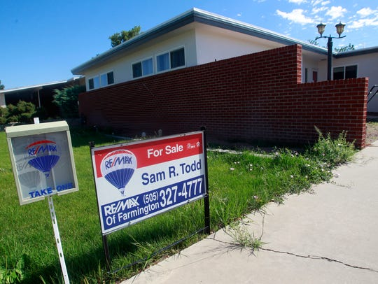 A for sale sign is posted Wednesday in Farmington.