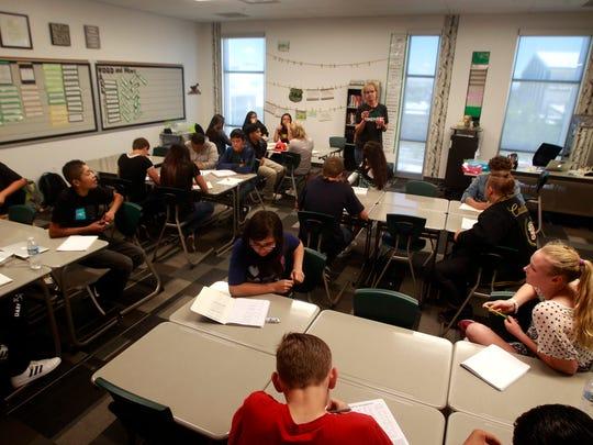Teacher Beth McDaniel Hill leads a class discussion Friday at Farmington High School.