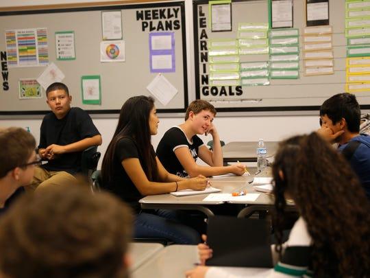 Students participate in Beth McDaniel Hill's English class Friday at Farmington High School.