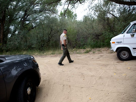 San Juan County Deputy Mike Rietz, a sex offender registration and tracking unit member, makes contact with a registered sex offender Thursday in Aztec.