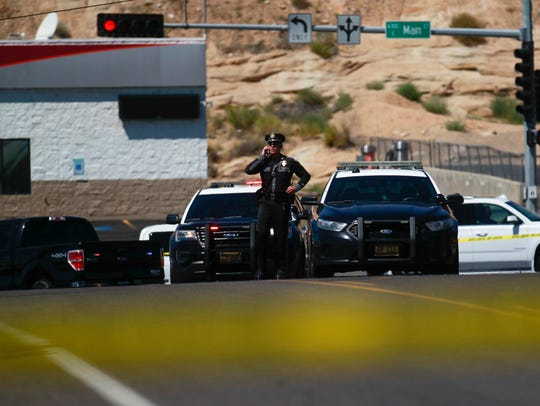 A New Mexico State Police officer secures the scene