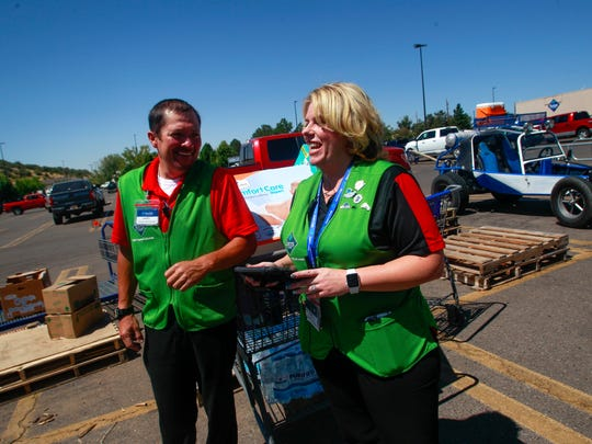 Sam's Club assistant managers Davey Lopez and Kim Horton watch as Four Corners Hope for Houston volunteers collect donations for Hurricane Harvey victims Friday in the Sam's Club parking lot in Farmington.