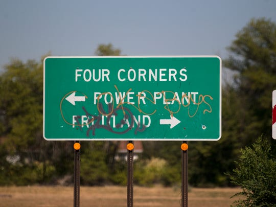 A sign points in the direction for the Four Corners Power Plant on Tuesday, Sept. 12, 2017 near Fruitland.