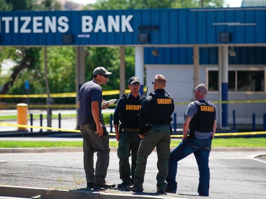 San Juan County Sheriff's Office personnel secure the location of a shooting Aug. 27 in the parking lot of the Citizens Bank location on Hudson Street in Farmington.