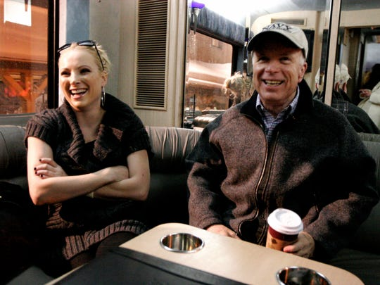 Meghan McCain and her dad, John McCain, on the 2008 presidential campaign trail.