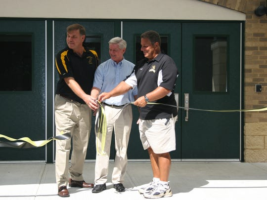 For Sophia Gonzalez...A look at the ribbon cutting and walk through for the new gym in Cresskill...Left to right...Rich Miller (Track/Field Coach), Marty Rivard (Boy's Basketball Coach), and Bob Valli (Football Coach)