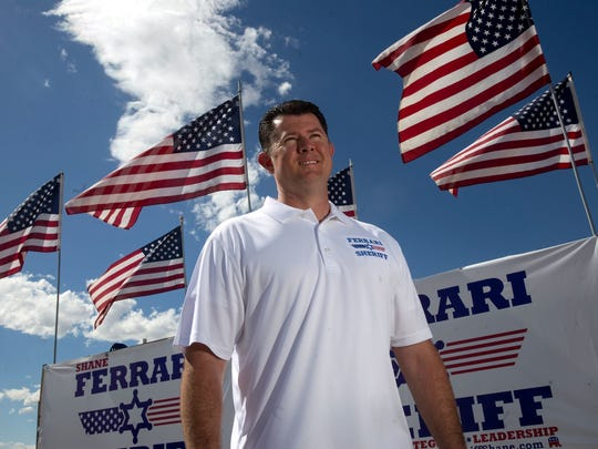 Shane Ferrari stands next to campaign signs, Thursday, Aug. 17, 2017 at McGee Park in Farmington. Ferrari is running for San Juan County Sheriff.