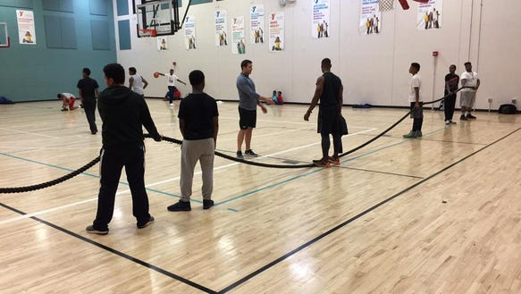 Boys get ready for tug of war during Social Fitness