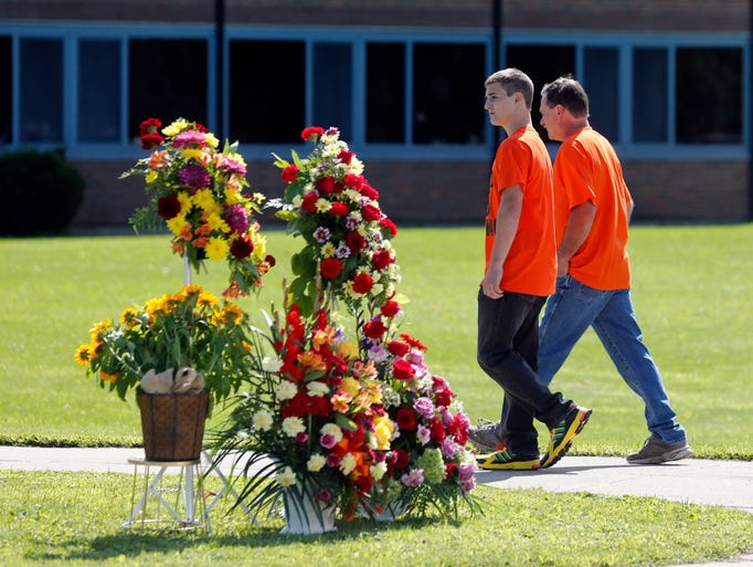 People walk to South Lewis Central School before a funeral for race car driver Kevin Ward Jr.
