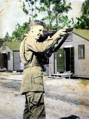 "Martin ""Matty"" Teahan, holding a Thompson submachine gun in Nottingham, England, in 1944."